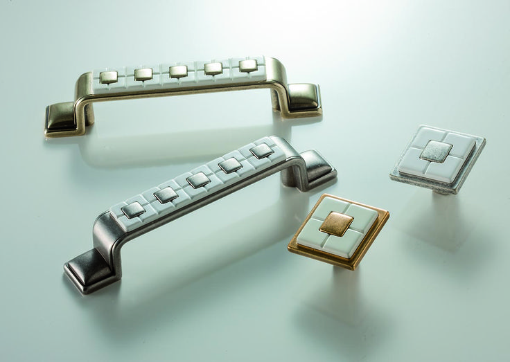 Citterio Giulio traditional handle line. In zamak and new white plastic finishes.