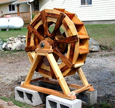 The runnerduck waterwheel plan is step by step for Garden pond building instructions