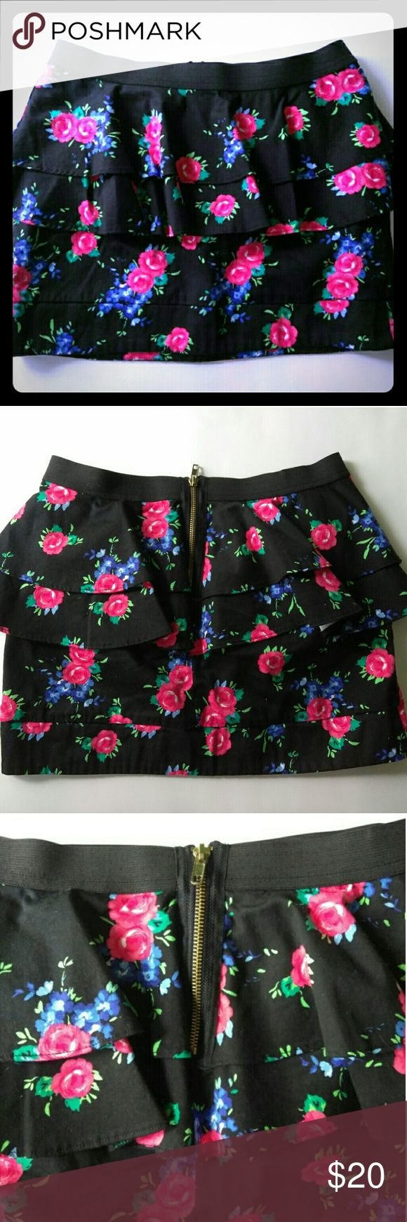 Floral peplum mini skirt, black/floral stretch A pretty floral peplum mini skirt with red/blue/green flowers on black.  Width: 17 inches Length: 13 inches Waist (layed flat): 14 inches 97% cotton, 3% spandex Made in China  Machine wash cold. Gentle cycle with like colors only non-chlorine bleach when needed. Tumble dry low. Low iron if needed. Do not dry clean.  Enjoy! Material Girl Skirts Mini