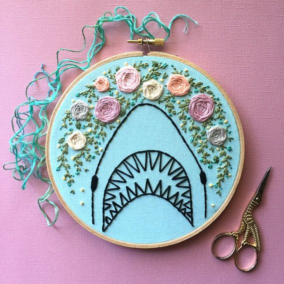 Shark hand embroidery with floral details, embroidered on light blue fabric, set in a 6 inch hoop