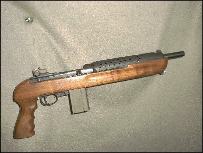 """30 carbine Enforcer pistol. A discontinued (1993) Iver Johnson """"Enforcer"""" pistol. Based on the cal. 30 M1 carbine, this pistol is only 18"""" long with a 10 1/2"""" barrel. It uses many of the origional GI parts, also used standard 30 carbine magazines."""