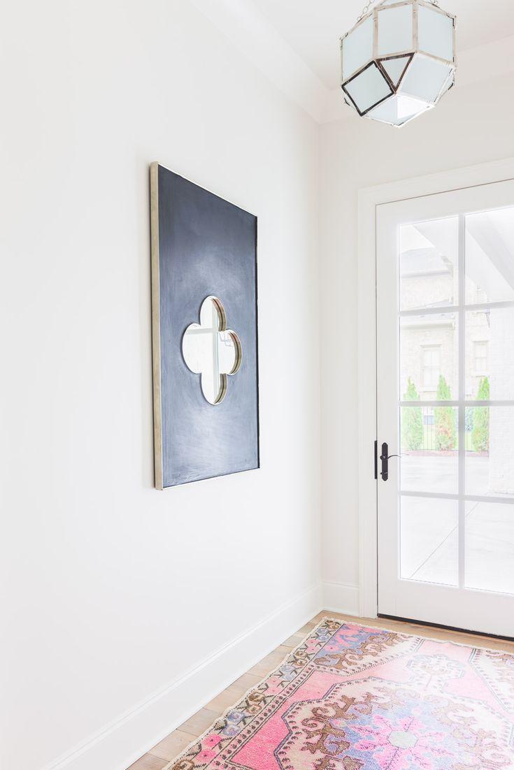 Alyssa Rosenheck - Redo Your House - A long white foyer features a Suzanne  Kasler Morris Lantern illuminating a black quatrefoil mirror, Noir  Quatrefoil ...