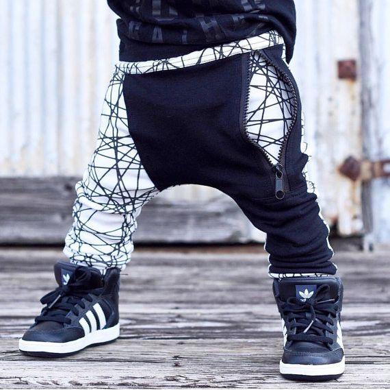 * Soft and comfortable drop crotch zipper joggers made of Organic cotton knit geo print and black Terry fabric * Black zipper pocket in the front * Black vertical pocket on the back (Right side) * Siz