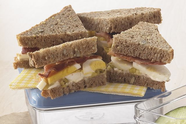 This might be the easiest egg salad sandwich ever! Just layer dressing, already-cooked bacon and pickle relish with a sliced hard-cooked egg on bread.