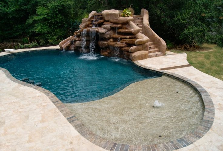 swimming pool Nice Shape Swimming Pool With Stone Decoration Wall And Mini Waterfall At The Backyard How to Determine the Great Pool Builders