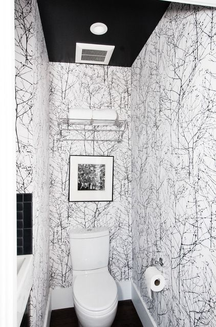Bold wallpaper in the bath room / powder room  graphic black and white forest wallpaper by Wintertree, Cowtan & Tout #TheHurstTeam #Houzz