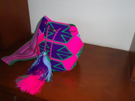 Wayuu Mochila  with Paleteado Strap  (Medium Size)   Certification of the Original   QUALITY: handwoven in only one thread. We only sell pieces of art  Colors:  Pink, Green, purpure, violet We give a Wayuu Bracelet (M)  Medium Size  with every bag  22  cms aprox  x 26 cms aprox    Description :Medium size, Wayuu mochila with Paleteado strap , manybright colors and different patterns . Every piece is unique and differentProduction : 100 units every   Price:  Euros $66 US$88