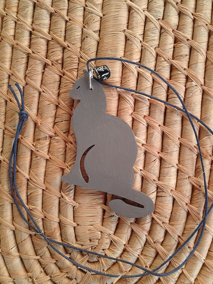 Wooden grey cat with long cord.