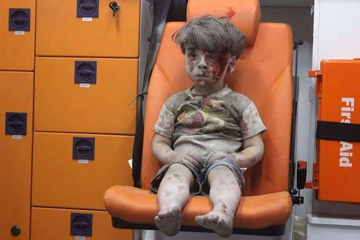 A haunting image of a five-year-old after an airstrike in Aleppo reminds all that the conflict is far from over.