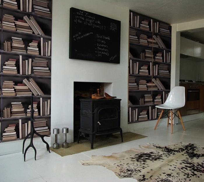 Vintage looking faux bookshelf wallpaper by Studiomold