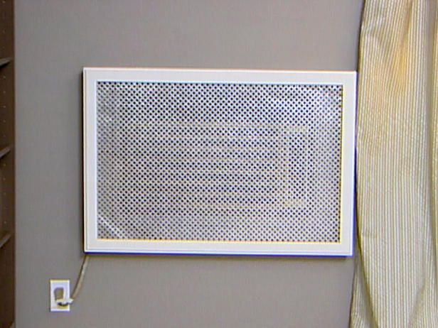 picture frame and metal grille covers air conditioner