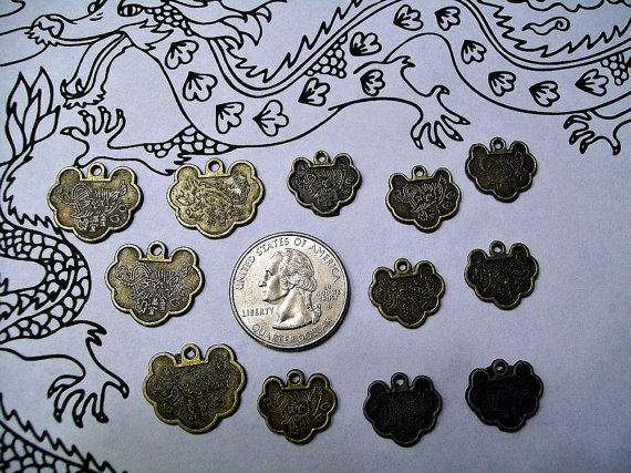 Dragon and phoenix Cloud-shaped Charm Coin Pendant set of 12 - Chinese New Year of the Dragon 2012. $3.60, via Etsy.