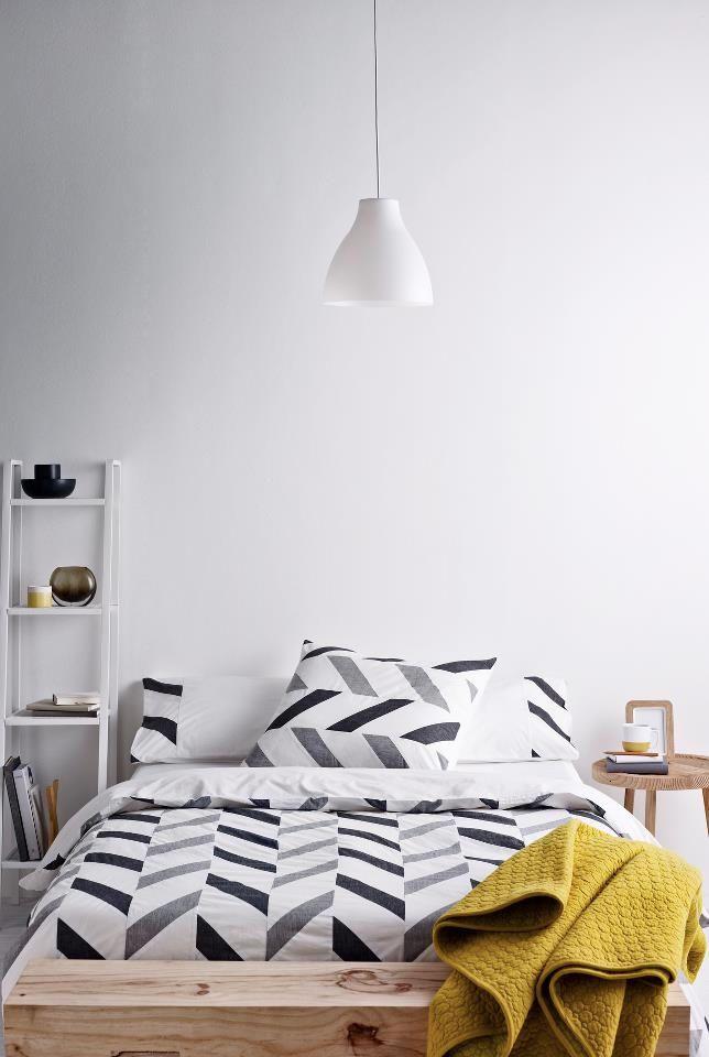 minimalist neutral chevron bedding in a modern bedroom