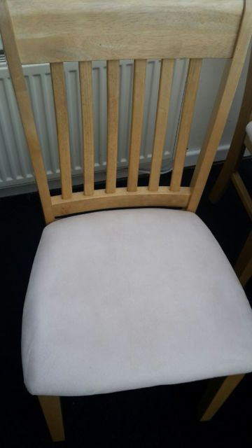 For Sale. A small dining table and 4 chairs in light coloured rubberwood. The table measured
