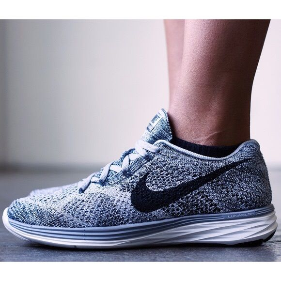 Nike Wolf Grey Flyknit Lunar 3 Sneakers •The Nike Flyknit Lunar 3 Women's Running Shoe pairs plush cushioning with an ultra-lightweight, incredibly strong Flyknit upper to help keep you comfortable—and keep you going—for miles. •Women's size 9.5. Will work for a 9 if you're going to actually use them for running. Better for a narrow-normal 9.5. Flyknit material so they are meant to have a snug fit. •New in box (no lid). •NO TRADES/PAYPAL/MERC/HOLDS/NONSENSE Nike Shoes Athletic Shoes