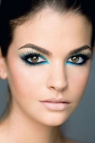 Add depth to your look by shading around your black eyeliner with a pretty blue.