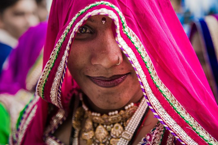 Hidden Smile - Indian woman at a wedding in Jodhpur, Rajasthan, India.  <a…