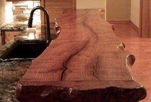 room with Caledonia Granite Countertop, Stone Forest - Natural Edge Hardwood Countertops