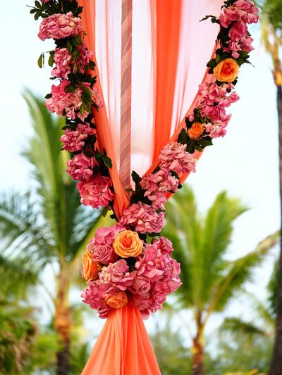 Sangeet Decor - Floral ties at the Mandap | Find more Indian wedding ideas at www.wedmegood.com | #weddingdecor #indianwedding