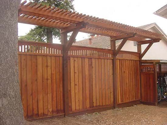 Fence with trellis across the back of the backyard. Would be so cool - just so expensive.