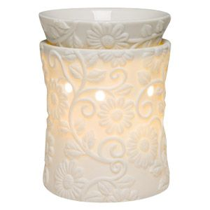 Happy spring flowers and curling tendrils dance in glowing white porcelain. To purchase, go to www.jenni.scentsy.com.au