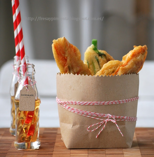 zucchini flower tempura inside which lurks a harmonious blend: creamy ricotta cheese  mixed with a tasty lobster