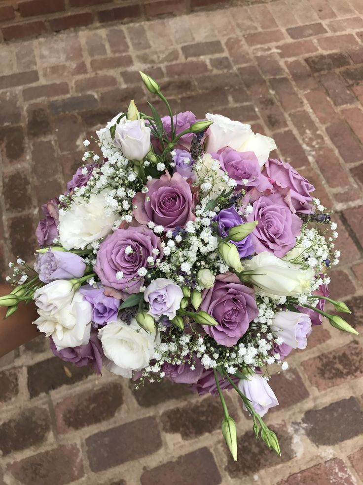 A beautiful purple & white bridal bouquet designed by Bliss Floral Creations