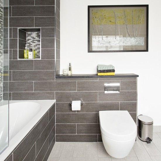 Modern bathroom with grey tiling and artwork