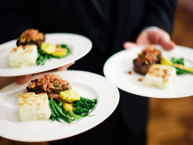 A plated dinner of beef, potatoes and green beans at wedding reception