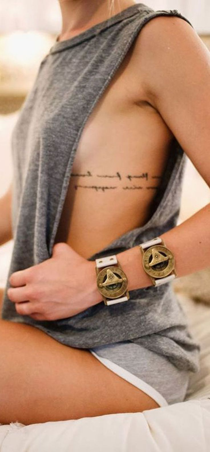 30 feminine rib tattoo ideas for women that are very for Small cursive tattoos