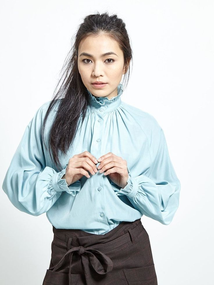 Sky blue Victorian ruffle blouse  • high neck • poet sleeves • tonal buttons Fabric Composition: 50% Polyester, 50% Rayon  Model is 173cm andwears: UK S/ EU...