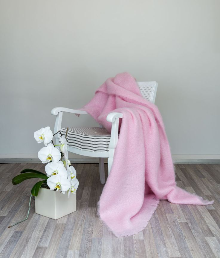 A pretty baby pink mohair throw or blanket works well in a feminine romantic room and of course in a little girls or babies room.