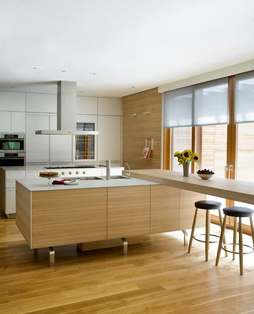 This design is very modern and different. I like the higher bar coming off the kitchen counter.