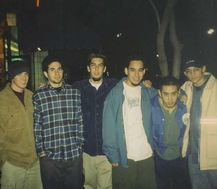 "Mike Shinoda_""1997 or 1998...I think this was the first photo we ever took together. We had just told Chester that we wanted him to join the band. He said he was ready to move out from Arizona to L.A. We went to a pizza place near UCLA to hangout and talk about what to do next. The band was called Xero at the time, and we probably had less than a half a dozen songs. No flame tattoos yet, no red hair yet, most of us were still in college"""