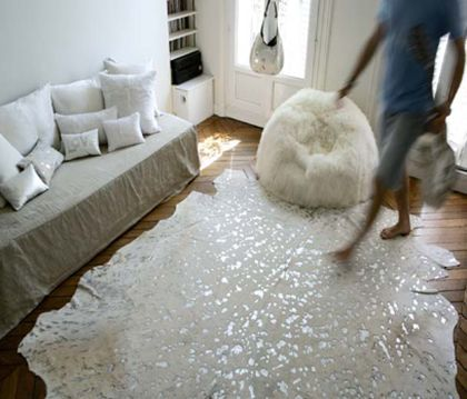 glitter rawhide rug and furry pouf. by Maison de Vacances.