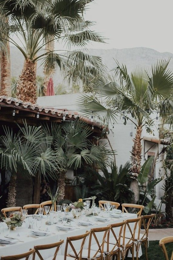 FOR THE RECEPTION || Tropical Palm Springs wedding with classic long white tables & cross back chairs || NOVELA BRIDE...where the modern romantics play & plan the most stylish weddings... www.novelabride.com @novelabride #jointheclique