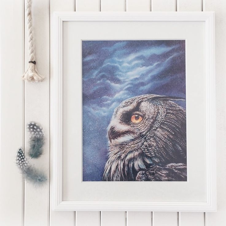 This home decor canvas print has a beautiful portrait of a great horned owl under an infinite sky of stars.