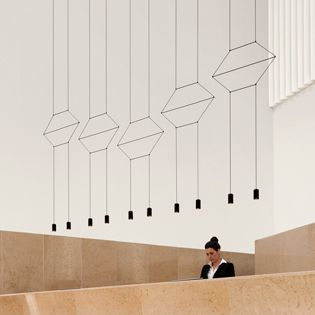 """WIREFLOW's electrical wire draws geometrical shapes in two or three-dimensions that, in spite of their large size, allow a see-through effect providing the light fixture with its captivating graphic essence. According to Levy, WIREFLOW combines """"presence and absence, transparency and luminosity, light and fluidity"""". http://www.vibia.com/en/lamps/show/id/03314/hanging_lamps_wireflow_0331_design_by_arik_levy.html"""