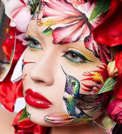 Girl's face painted with Hummingbird & flowers art