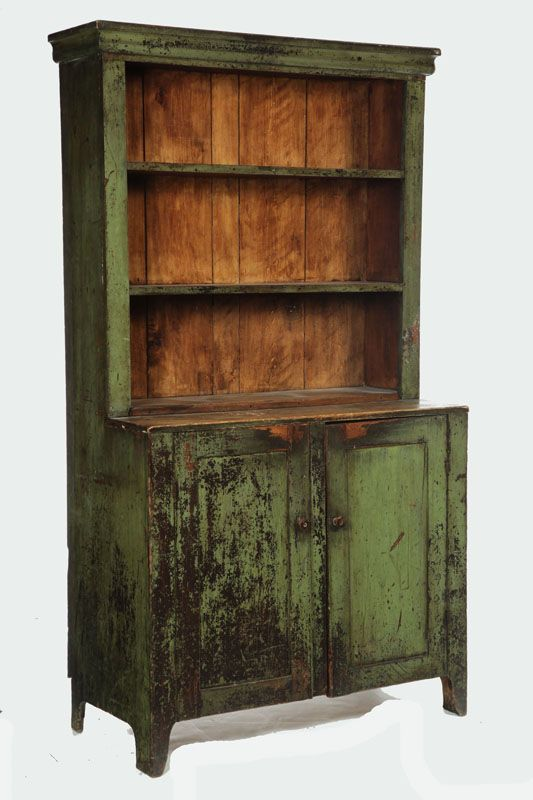American, Step-back cupboard, poplar, One-piece with open shelves over two doors, retains old green paint over earlier brown, 74.5 H. x 42.25 W. x 12.25 D.