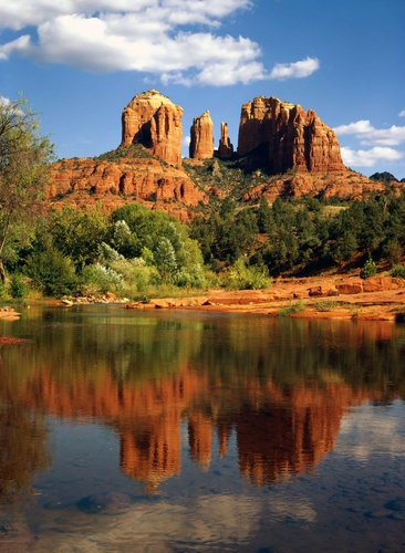 """Cathedral Rock is a famous landmark on the Sedona, Arizona skyline, and is one of the most-photographed sights in Arizona, USA. Cathedral Rock is located in the Coconino National Forest in Yavapai County, about a mile west of Arizona Route 179, and about 2.5 miles south of the """"Y"""" intersection of Routes 179 and 89A in uptown Sedona. The summit elevation of Cathedral Rock is 4921 ft."""
