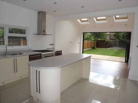 kitchen with bi-fold doors and skylight