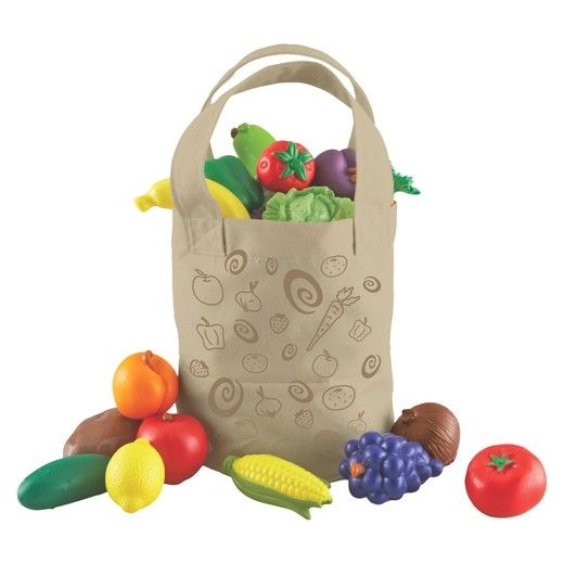 """""""Fill a tote with nutritious, freshly designed produce and invite early dramatic play! Soft, rubberized plastic produce has a spunky look that little sprouts will love! <BR/> Set of 17 includes red apple, tomato, strawberry, apricot, carrot, lettuce, pear, cucumber, berry cluster, plum, grapes, corn, banana, lemon, onion, potato and storage tote <BR/> Durable canvas tote measures 8""""H x 9""""W <BR/&#62..."""