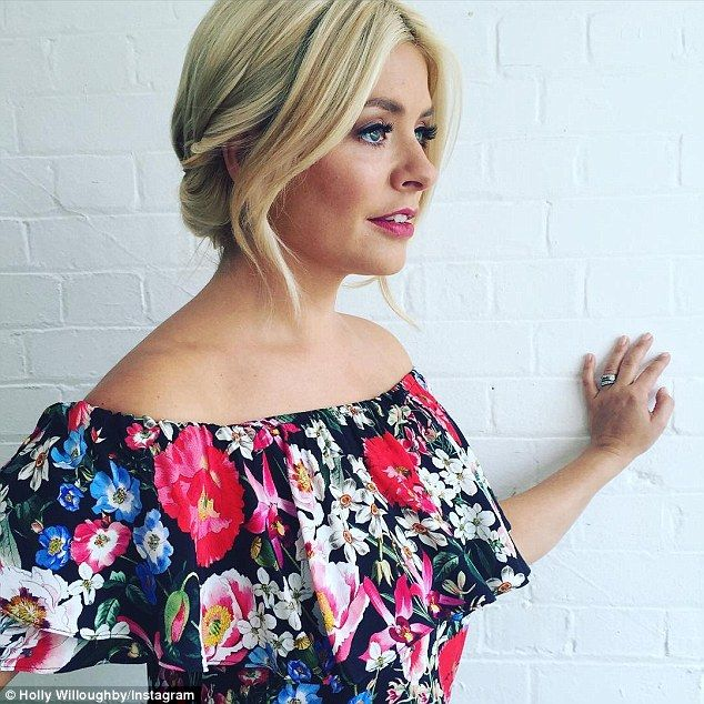 Different look: Holly usually sports a full face of make-up and perfectly coiffed locks for her This Morning appearances - and her fans praised her for going make-up free and embracing her freckles