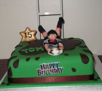 Rugby league cake scoring a try. Fun birthday party idea.