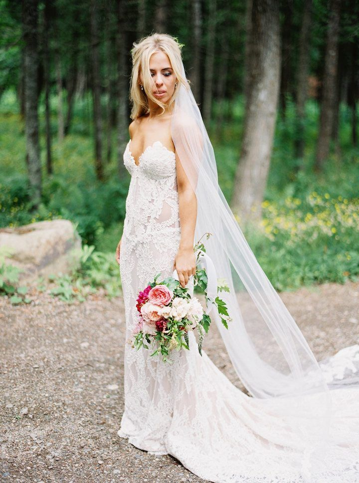 This Canada wedding was filled with elegant stationery, rustic greenery and such a decadent dessert table with multiple cakes! Photographs by Caileigh