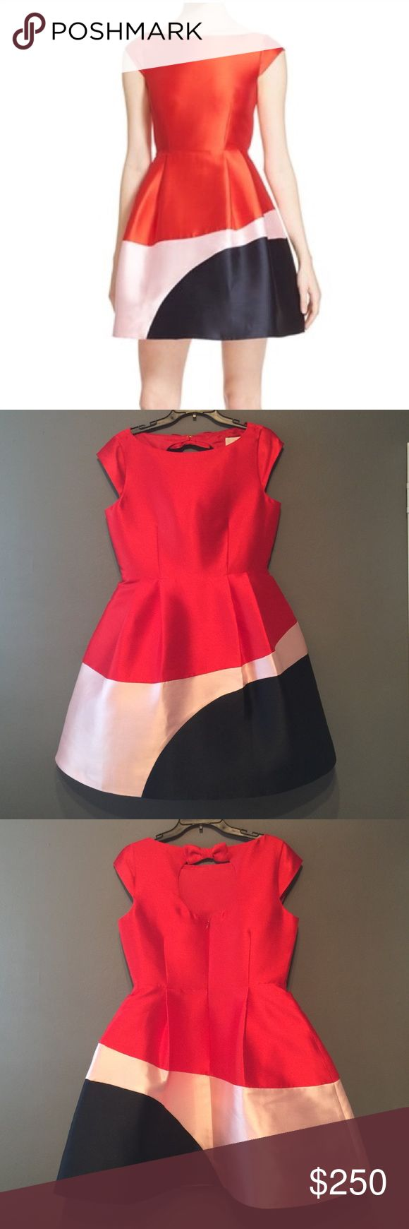kate spade color block fit and flare dress NWT kate spade color block fit and flare dress NWT. Super cute cocktail dress!! Red, with a blush pink and navy blue bottom. 89% polyester, 11% silk. Snap closure at the back of the neck (bow) zips up in the back. Comes with original plastic covering bag. I love this dress so only will sell if offer is right! ❤️ kate spade Dresses