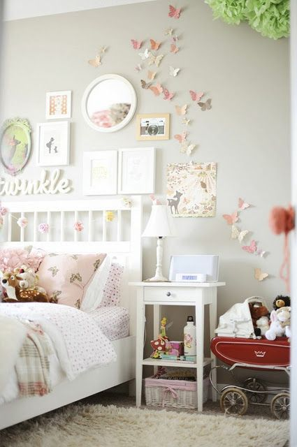 ADORE the butterflies flying up the wall of this little girl bedroom.