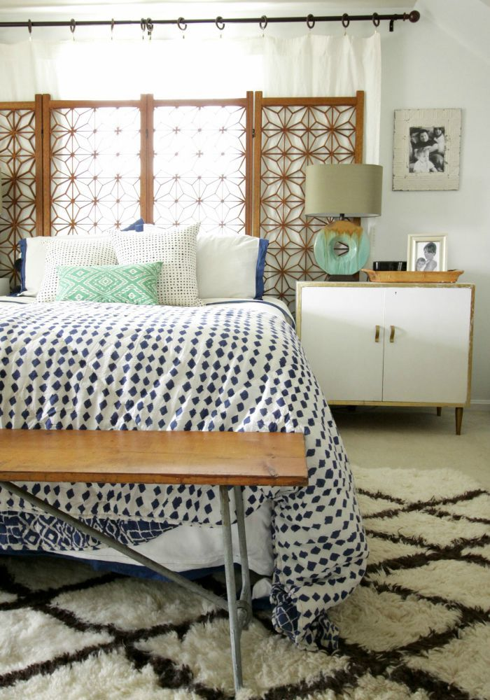 Master Bedroom Progress- White Walls in this eclectic bright modern vintage space.  This bedroom has a great modern bohemian feel with a vintage folding screen as headboard!  Love the mix of blue, white, wood, and green.