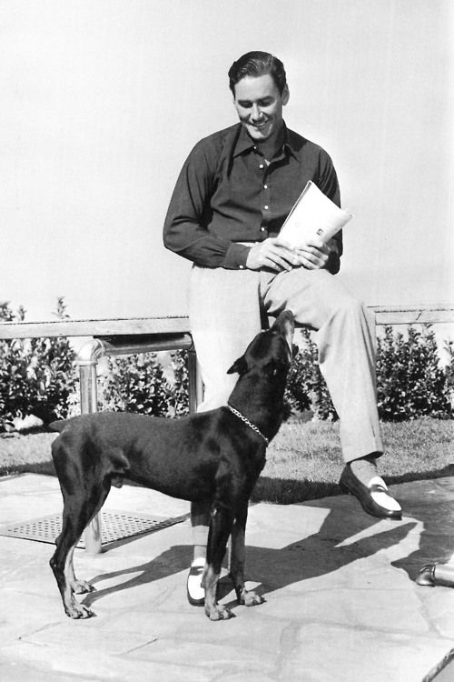 Errol Flynn with his dog at his home in Mulholland Farm (1940s)